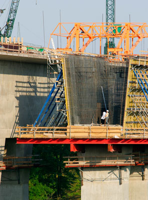 Bridge inspectors on scaffolding during maintenance